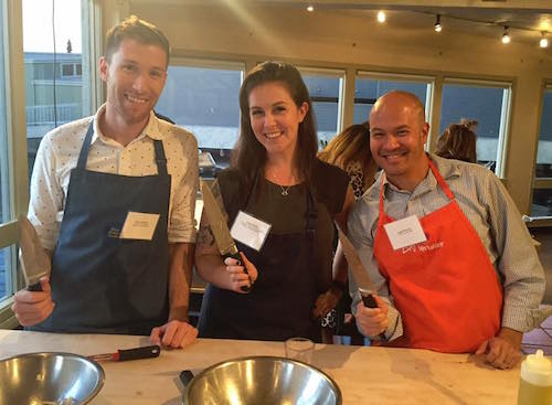 Chris Vogliano, Ginger Hultin and Angel Planells cooking together